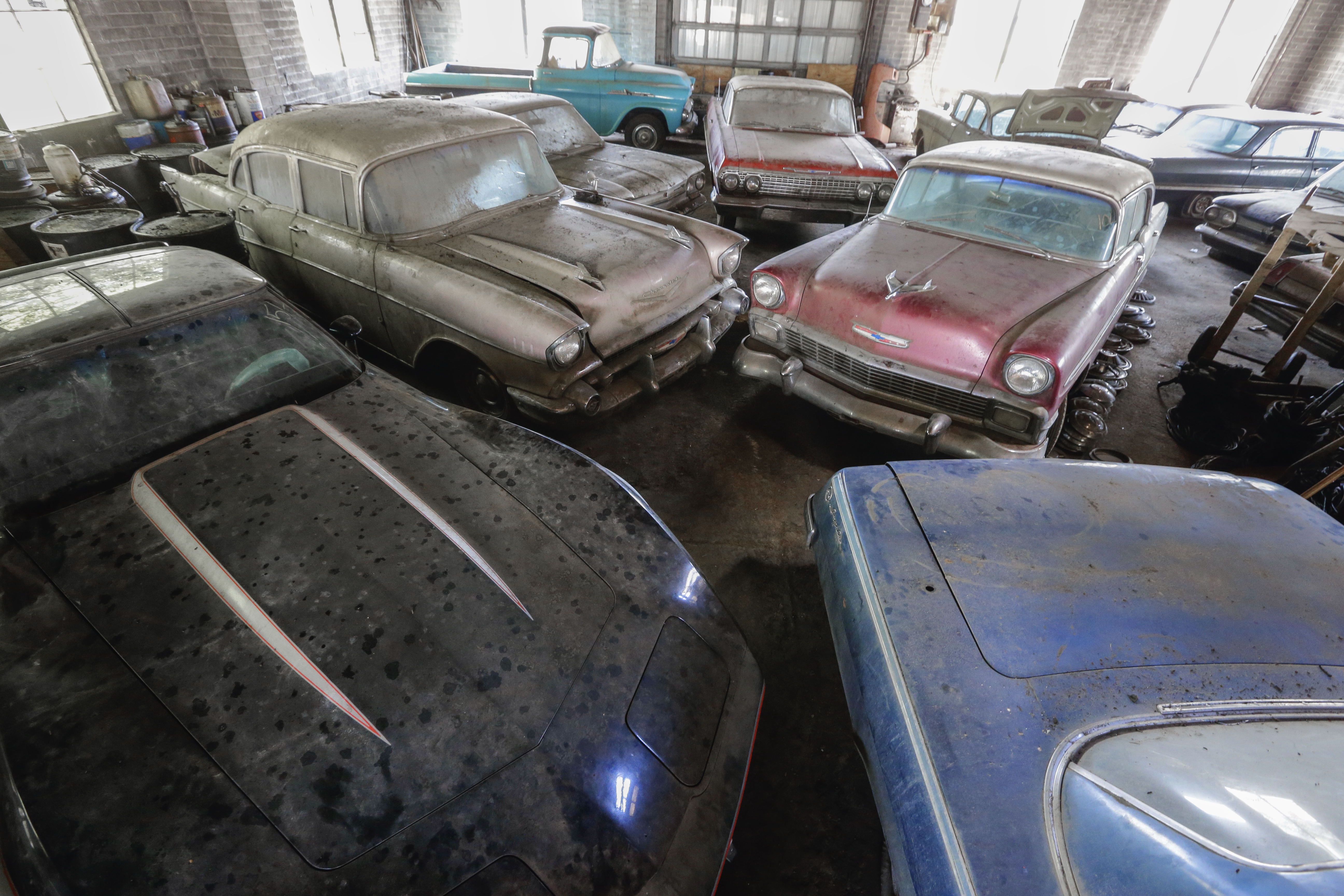 A file photo from August shows some of the cars that had been stored in the old showroom of the former Lambrecht Chevrolet dealership. At this weekend's auction, several of the previously unsold vehicles will come with their original paperwork and a new Nebraska title and bill of sale.