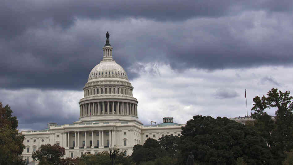 The federal government remains on track to miss a midnight Monday deadline to fund its operations. Chambers of Congress sharply disagree over a temporary funding bill. Here, the Capitol is seen Saturday.