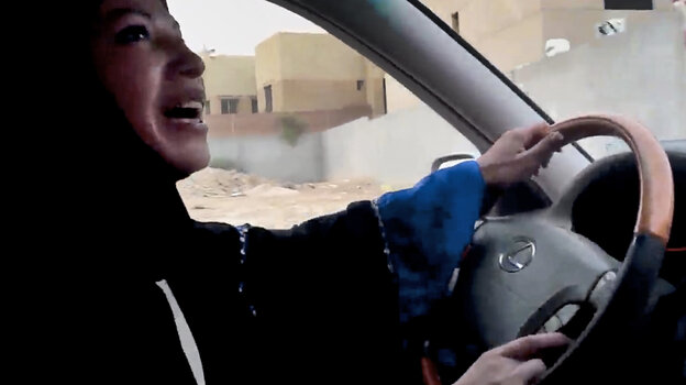 A file image taken from a video released by Change.org shows a woman driving a car as