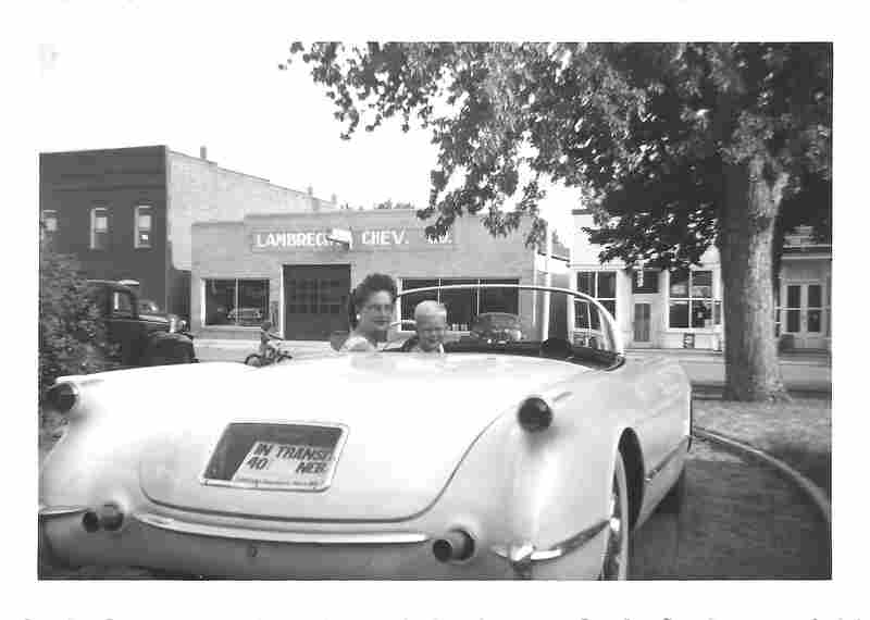 A family photo provided by Jeannie Stillwell, daughter of car dealership owner Ray Lambrecht, shows Mildred Lambrecht, Ray's wife, and their son Mark in a brand new 1953 Corvette, in front of the dealership.