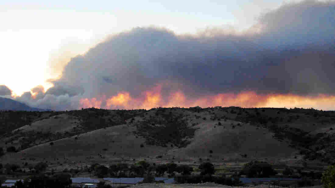A wildfire in burns Prescott, Ariz., on June 18. The fire would eventually take the lives of 19 firefighters in an area near Yarnell.