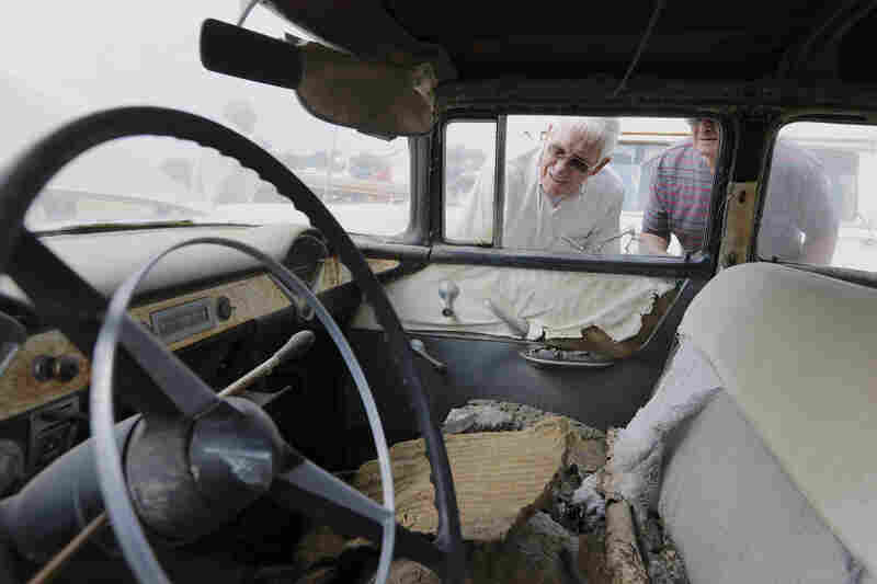 Car buffs look at a 1956 Chevrolet Bel Air four-door sedan during a preview for an auction of vintage cars and trucks from the former Lambrecht Chevrolet dealership Friday.