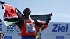 Wilson Kipsang from Kenya celebrates winning the 40th Berlin Marathon in Berlin, Germany on Sunday. Kipsang set a new world record of 2:03:23.