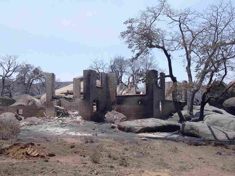 A house destroyed by a wildfire in Yarnell, Ariz. Experts say increasing expansion into wildfire-prone areas has created new challenges for firefighters unequipped to protect houses and structures.