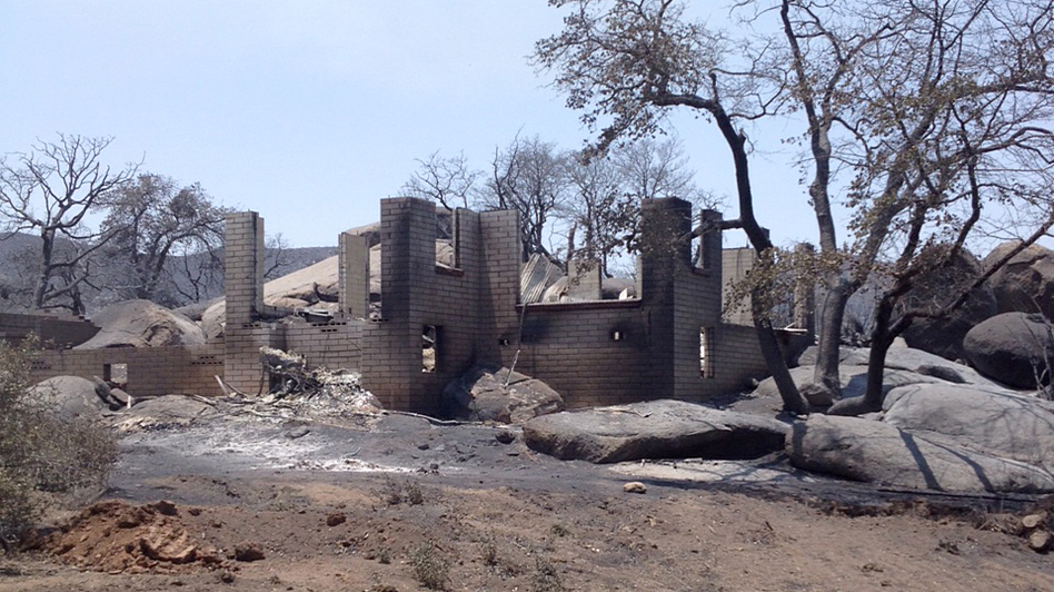A house destroyed by a wildfire in Yarnell, Ariz. Experts say increasing expansion into wildfire-prone areas has created new challenges for firefighters unequipped to protect houses and structures. (AP)