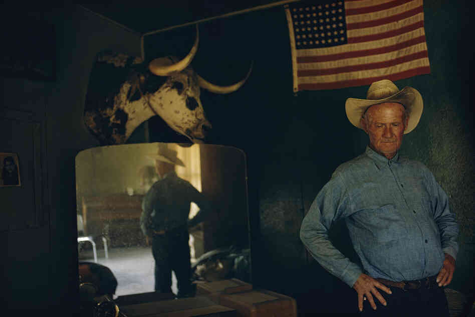 """Henry ran cattle for 50 years on the Organ Pipe Cactus National Monument desert country. He was 72. The government wanted his cattle off the land. As we moved about the house, Henry paused, lost in his thoughts, behind him a 48-star flag."" Arizona, 1970"
