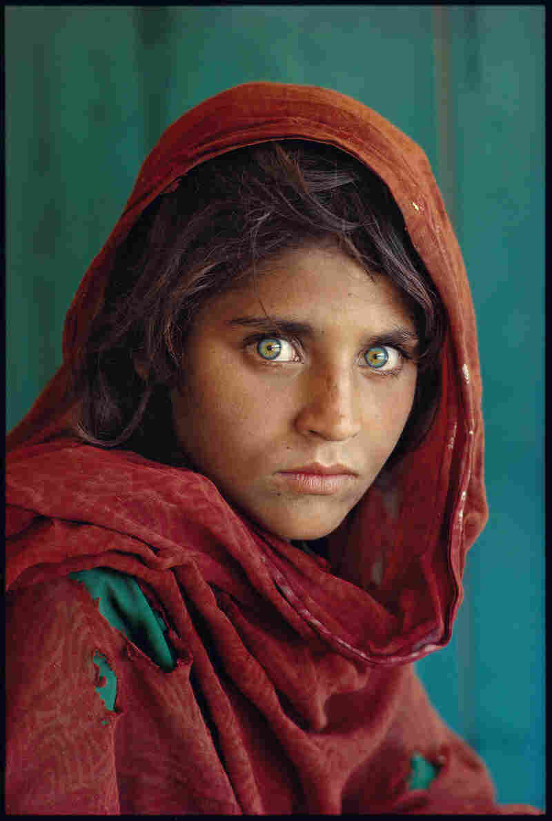 Steve McCurry's iconic photograph of a young Afghan girl in a Pakistani refugee camp appeared on the cover of National Geographic magazine's June 1985 issue and became the most famous cover image in the magazine's history.