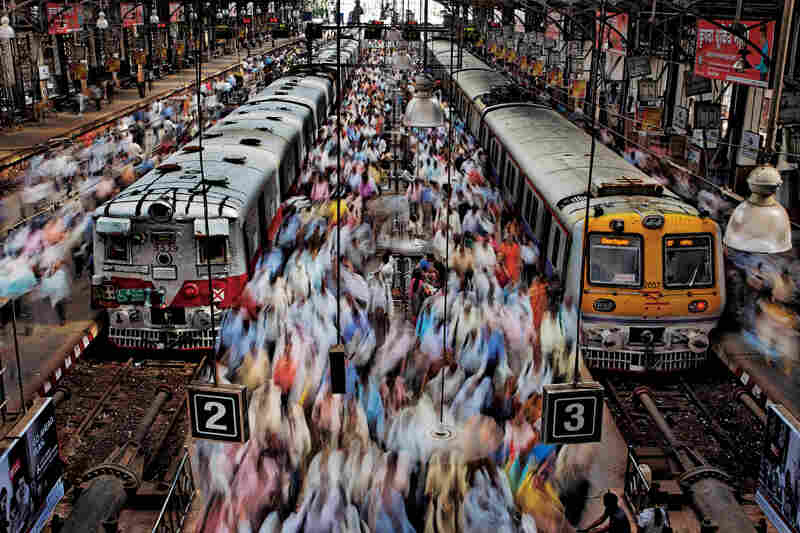 "Seeking to capture the throng in Churchgate Station, Randy Olson coached a local assistant through the laborious process needed to get this shot, because the perfect vantage point was closed to foreigners. ""After four hours we had this picture — and a small victory over Indian bureaucracy."" Mumbai, 2011"