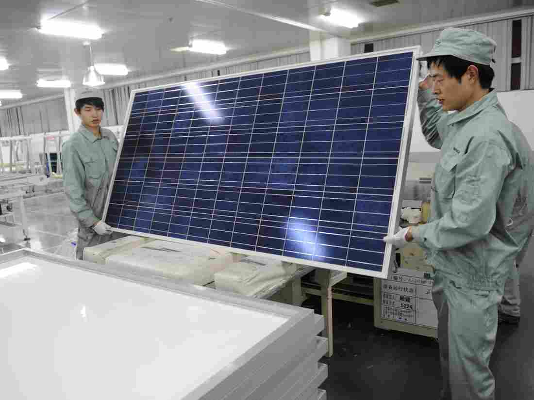 Workers assemble solar panels at the now-bankrupt Suntech in the eastern Chinese city of Wuxi. Overproduction in the country has helped lower the cost of solar panels.