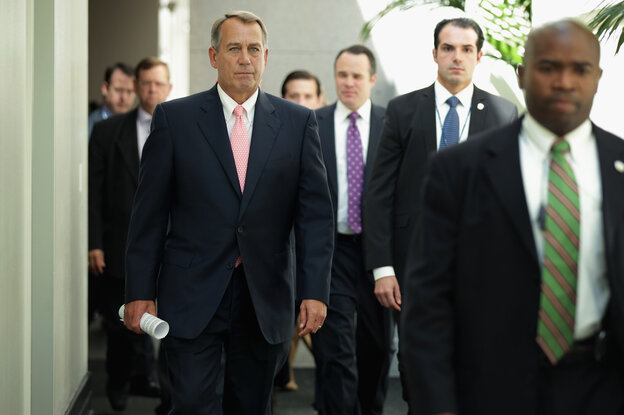 Speaker of the House John Boehner, a Republican from Ohio, arrives for a Republican Conference meeting at the U.S. Capitol on Friday in Washington, D.C.