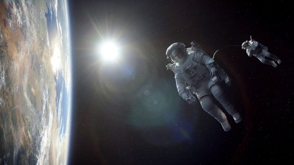 George Clooney and Sandra Bullock play astronauts marooned in space in Gravity, a visual marvel of a movie from director Alfonso Cuaron.  (Warner Bros.)