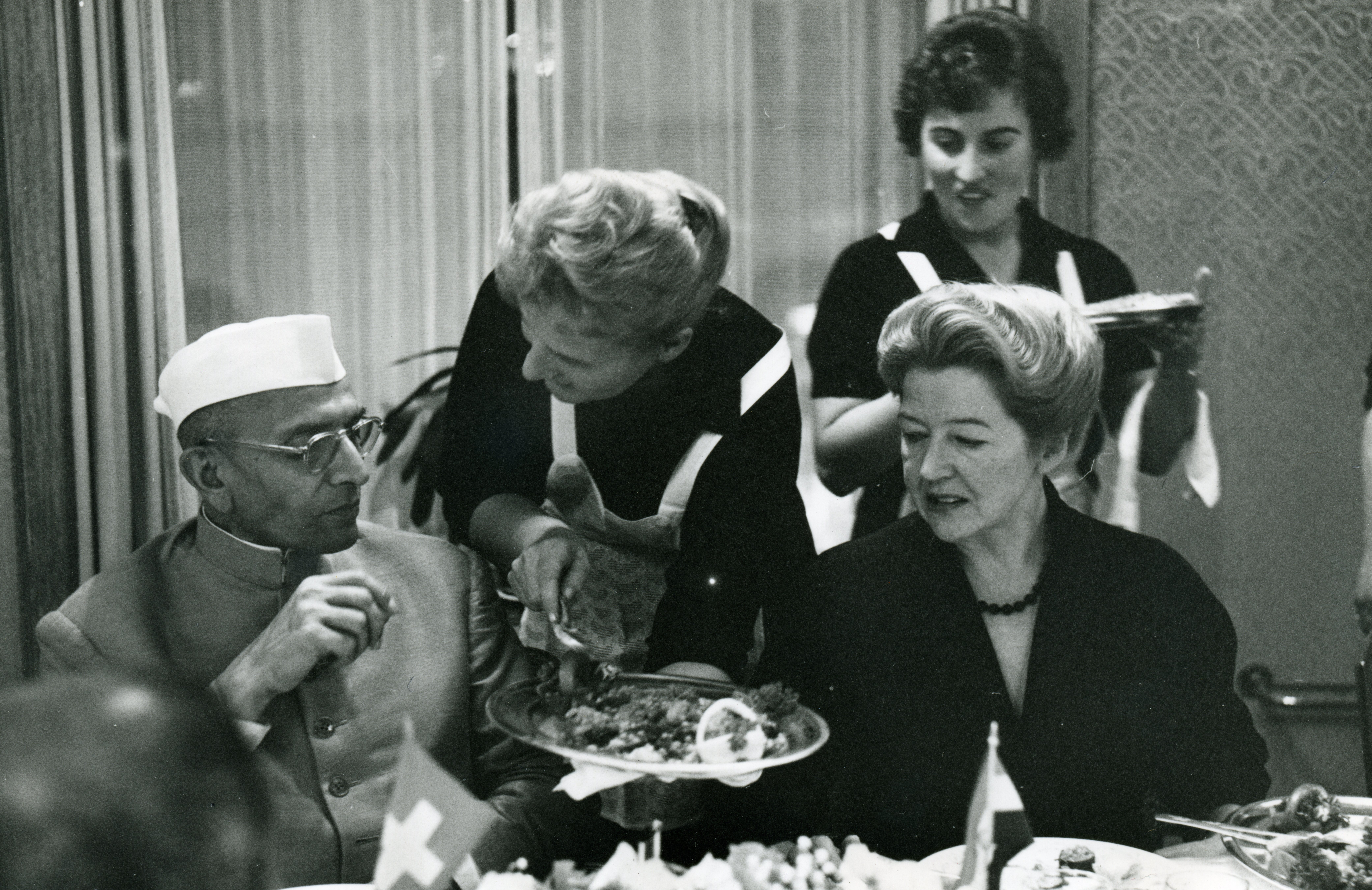 Margrith Hiltl (seat at right) brought Eastern influences to Hiltl's menu after traveling to India in the early 1950s. Here, she's seen dining with Indian Prime Minister Morarji Desai.