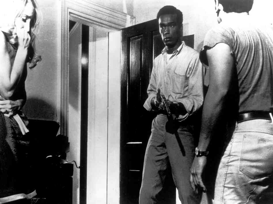 Duane Jones (second from right) makes zombie history as Ben in Night of the Living Dead.