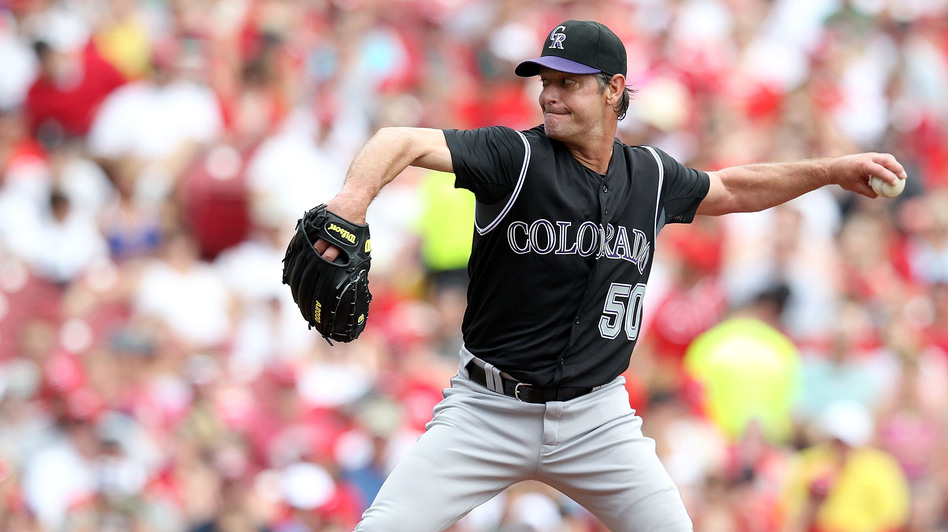"Jamie Moyer, shown above pitching for the Colorado Rockies in May 2012, made his major league debut back in 1986. He says that after decades in the major leagues, he'd occasionally have to remind himself that ""in baseball terms, I really was old, but in everyday life, I really wasn't."" (Getty Images)"