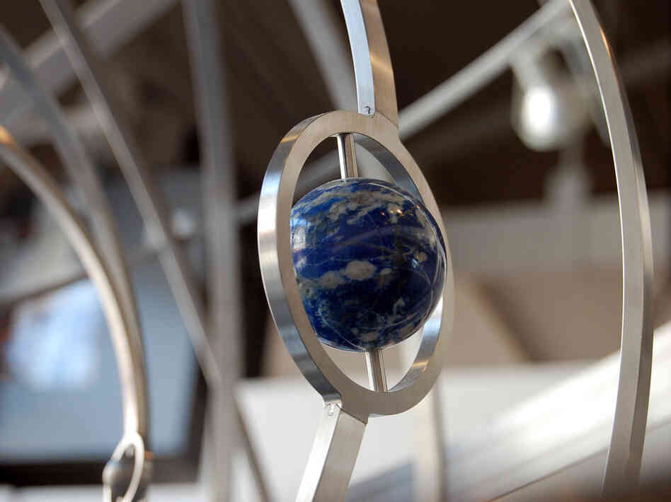 A detail of the prototype orrery for the Clock of the Long Now.