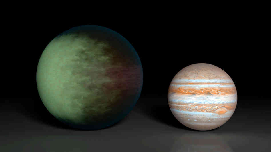 An artist's rendition of Kepler-7b (left) with Jupiter for comparison.