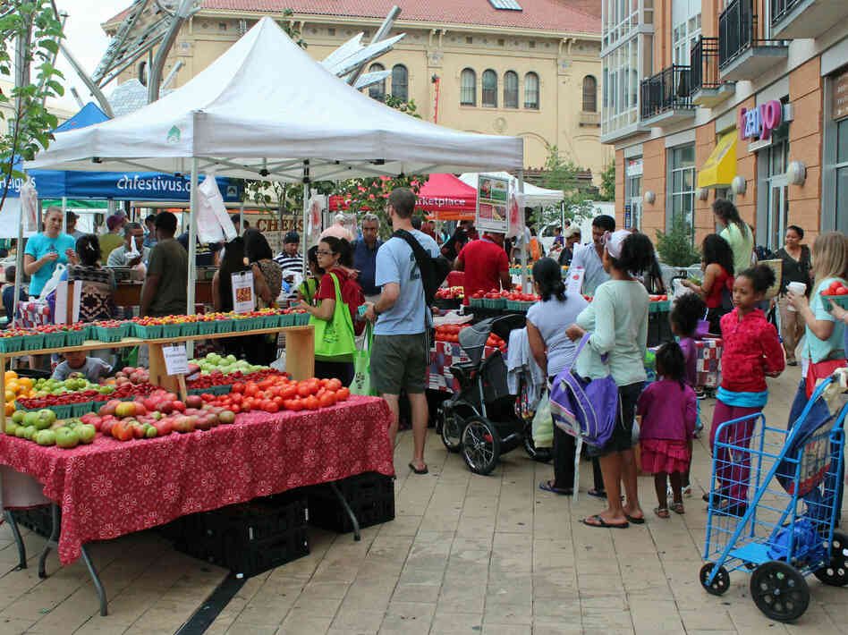 At a farmers market in Washington, D.C., recipients of federal food assistance like the WIC program can use vouchers to buy fresh fruits and vegetables.