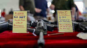 A sign warns would-be buyers at the Annapolis Gun Show in Annapolis, Md., in September of the state's pendi