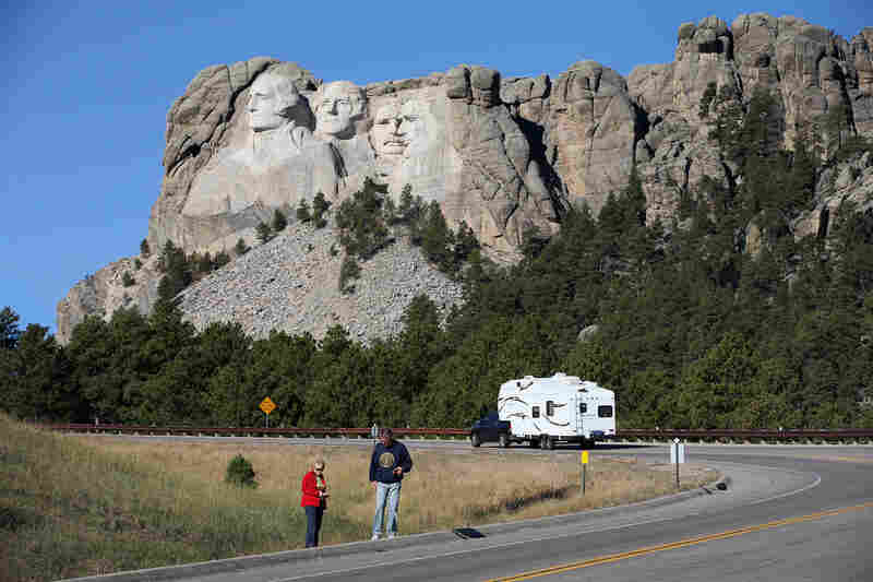 The Department of the Interior issued a bulletin ordering national parks, including Mount Rushmore in Keystone, S.D., to suspend all activities and tell visitors to leave.