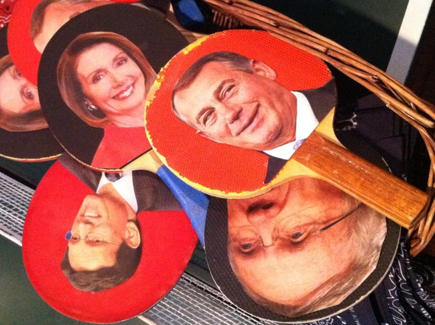 To lighten the mood, organizers provided Ping-Pong paddles decorated with head-shots of party leaders in Congress.