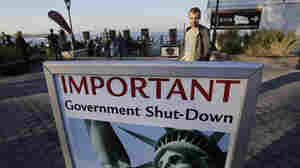A sign announces the closing of the Statue of Liberty on Tuesday.