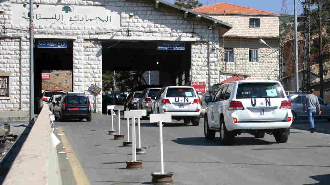 A U.N. convoy crosses the Lebanon-Syria border Tuesday, as a chemical weapons disarmament team crosses into Syria to begin the task of inventorying the country's arsenal of banned weapons.