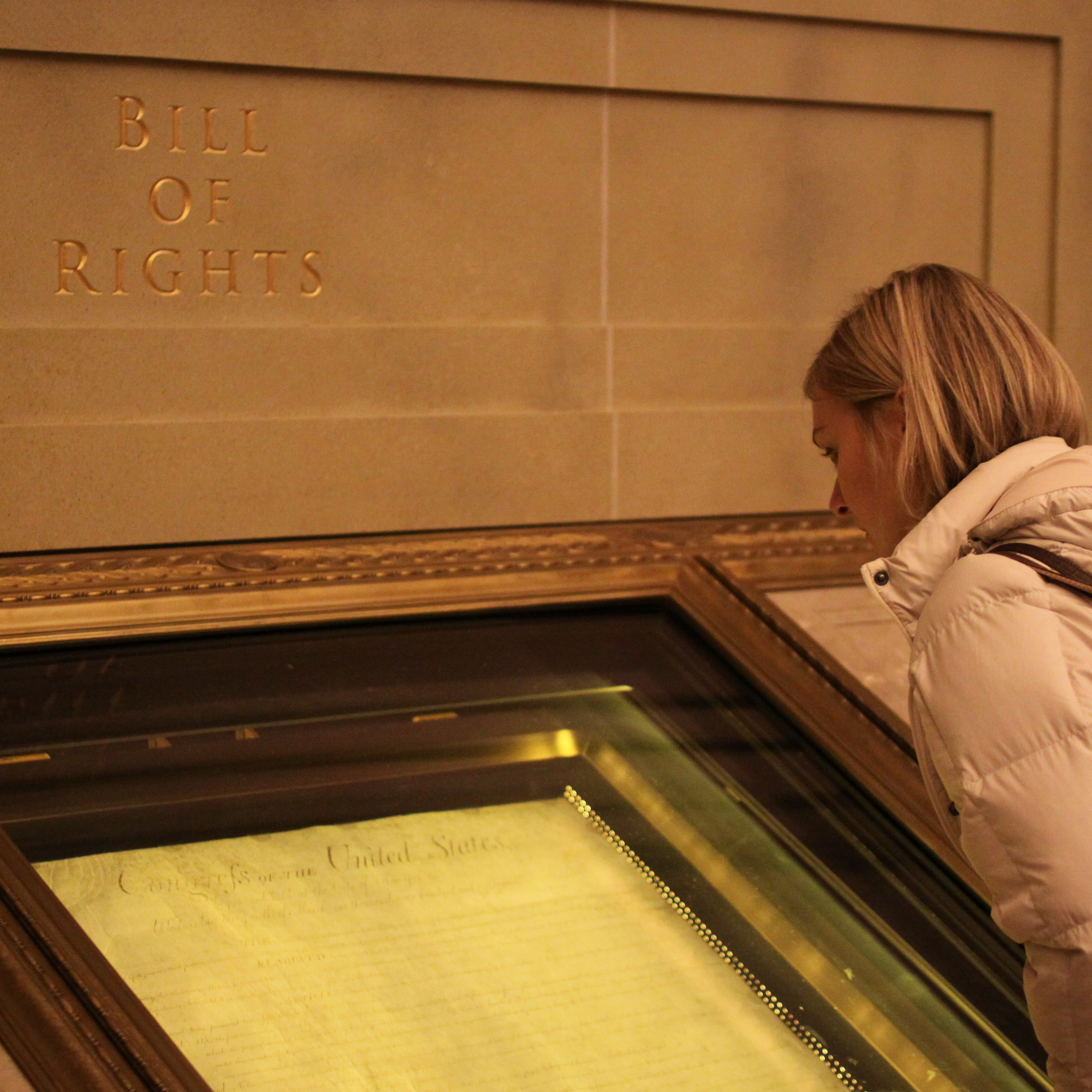 A visitor to the National Archives in Washington, D.C., looks over the U.S. Bill of Rights. But how the Fourth Amendment is applied in a digital age is still being discussed in federal and state courtrooms.