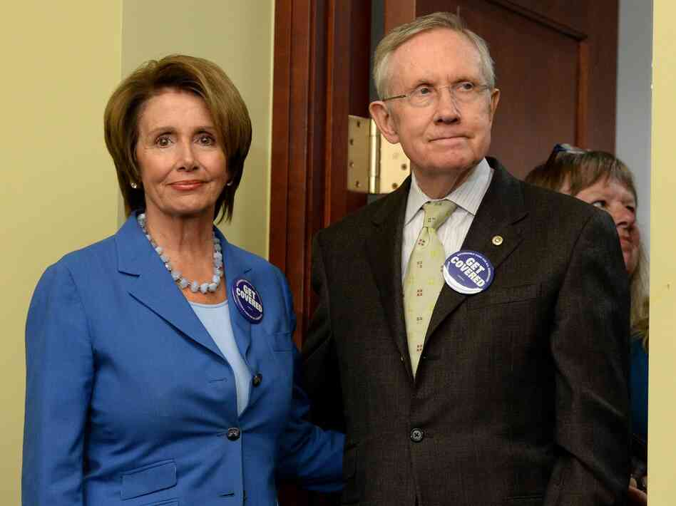 House Minority Leader Nancy Pelosi and Senate Majority Leader Harry Reid celebrate the open enrollment of the Affordable Care Act on
