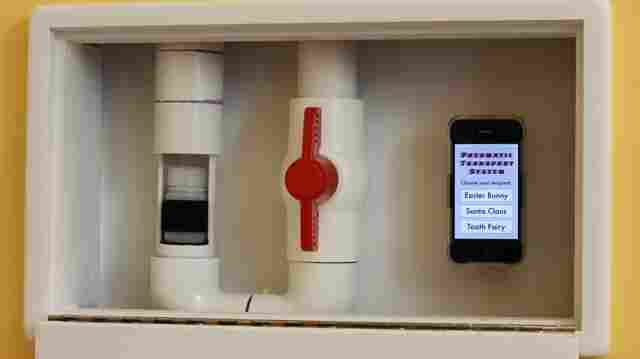 The pneumatic transport system, which carries a capsule from one end to the other, is controlled by a valve and an iPhone app. The app also includes sending options for the Easter Bunny and Santa, although they haven't been developed yet.