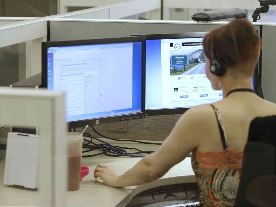 An employee of Covered California works in the newly opened call center