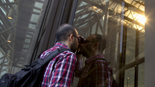 Rasim Akin Sevimli of Turkey tries to peer through the glass of the closed Smithsonian National Air and Space Museum on Tuesday — his only chance to see the museum before leaving Washington, D.C.