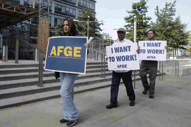 Darlene Tinsley, secretary-treasurer of the American Federation of Government Employees, leads protesters in front of the Anthony J. Celebrezze Federal Building in Cleveland.