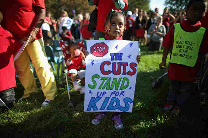 Children from the Washington, D.C., Head Start program join supporters and lawmakers outside the Capitol on Wednesday to call on Congress to fund the comprehensive education, health and nutrition service for low-income children and their families.