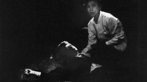 Rigid, semiconscious, his face an ashen mask, Kennedy lies in a pool of his own blood on the concrete floor, a bullet deep in his brain and another in his neck. Juan Romero, a busboy whose hand Kennedy had shaken before the shots, tried to comfort him.