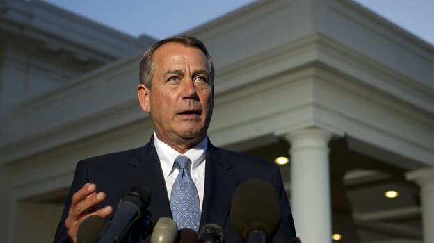 House Speaker John Boehner speaks to the media after a meeting with President Obama at the White House on Wednesday. (AFP/Getty Images)
