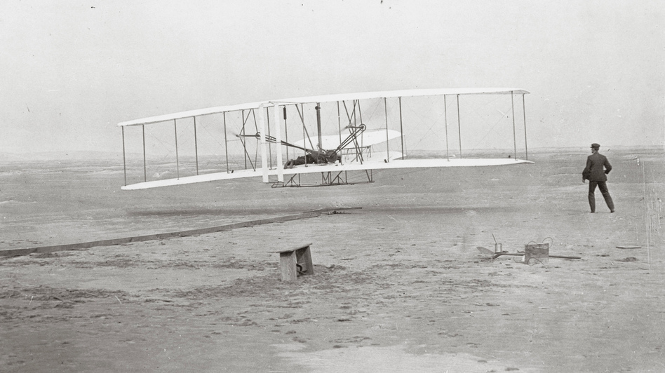The Wright Brothers Flyer lifts off in Kitty Hawk, N.C., on Dec. 17, 1903. Now 110 years later, a thriving aviation industry is looking to fill jobs in high-tech manufacturing.