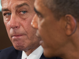President Obama, with House Speaker John Boehner, speaks to the media in the Cabinet Room of the White House on Sept. 3.