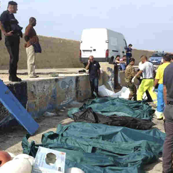 Some of the victims recovered after Thursday's wreck of a ship near Sicily were placed in body bags before being brought ashore to the island of Lampedusa.
