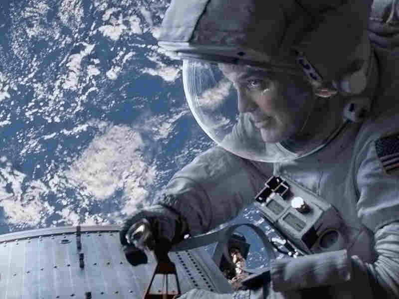 The astronauts (Bullock and George Clooney) were repairing the Hubble Telescope before their shuttle was hit with debris.