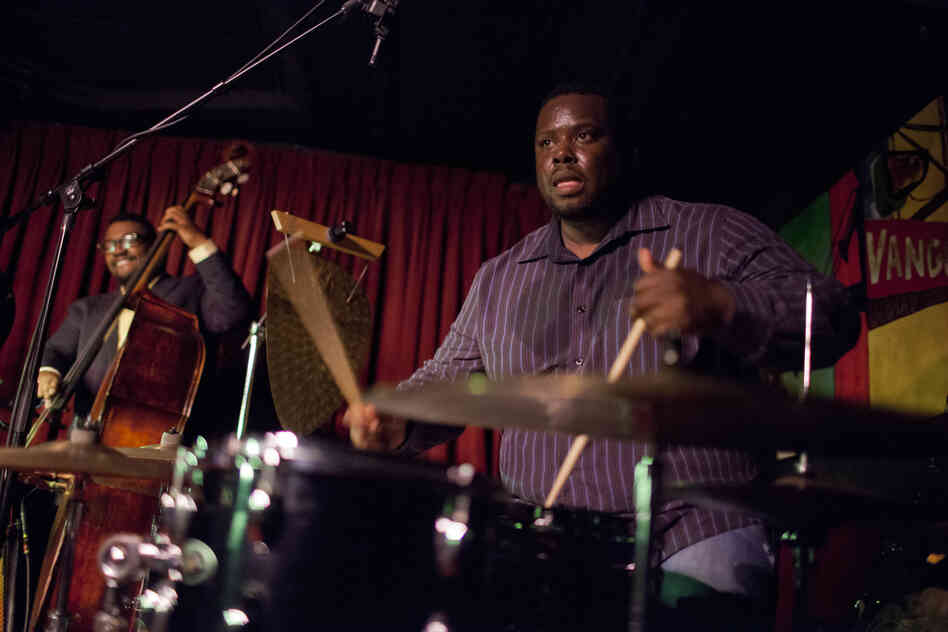 Johnathan Blake (drums) and Dezron Douglas.