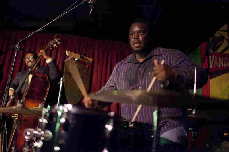 Johnathan Blake (drums) and Dezron Douglas.