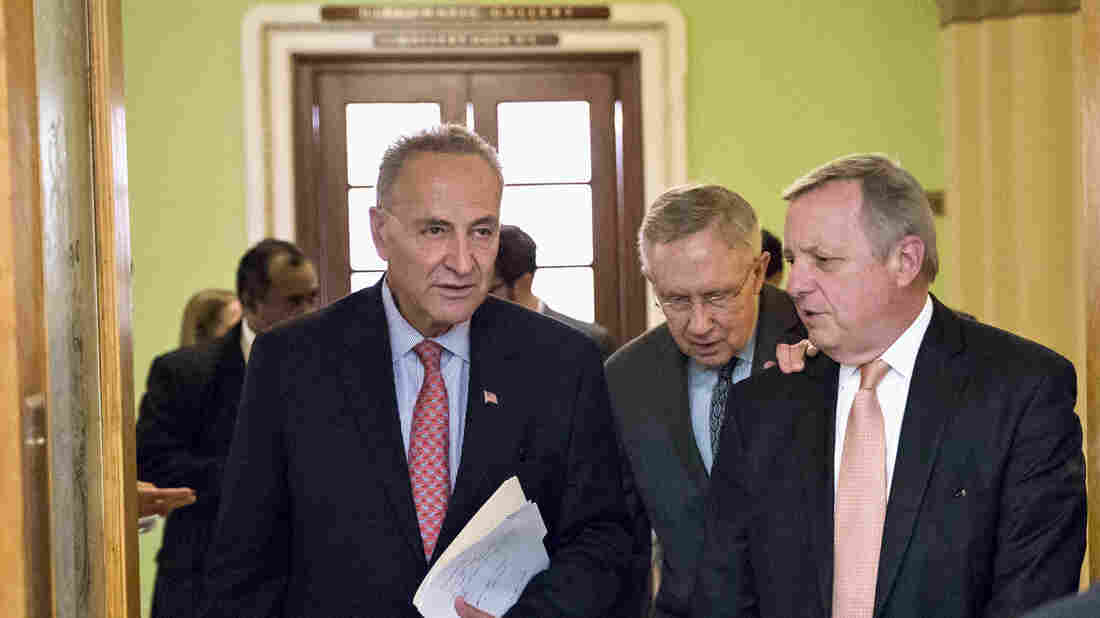 Sen. Chuck Schumer, D-N.Y. (from left), Senate Majority Leader Harry Reid, D-Nev., and Sen. Dick Durbin, D-Ill., head for a news conference Thursday on Capitol Hill.