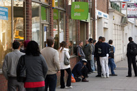 Job seekers line up outside a work support office in London in 2009. New measures proposed by the Conservative-led government will require recipients of unemployment benefits to do unpaid community work, spend workdays at a job center or participate in intensive programs to help solve personal issues that prevent them from working.