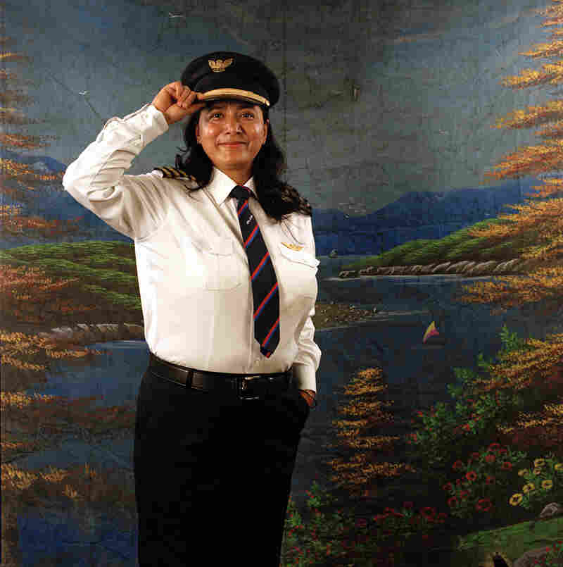 "Sony Rana is the first Nepali female pilot. She works for Nepal Airlines. ""People used to get shocked to see a woman landing a plane in their fields. Fortunately there was no discrimination in my field. In aviation you have to be perfect and not make any distinctions. I would like to give education for every little kid and every women of Nepal."""