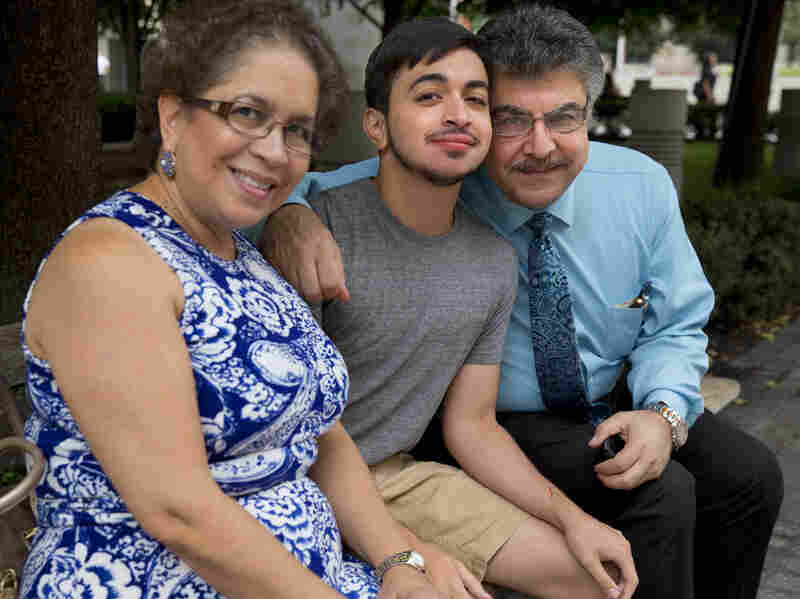 """Younes with his mother, Lina, and father, Badri. """"At certain moments, we thought, 'Why us? Why us? You know, God, we didn't need this,' """" his father said. """"But I say it now, thank God it was us."""""""