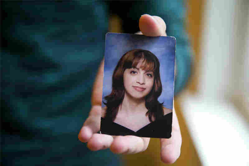 """Younes holds a senior portrait picture of himself in high school when he was formerly Mariam. Being beautiful equated to becoming a good daughter in Younes' experiences with his family. """"All I knew was that I was a girl and I had to be a girl and inside, I didn't feel that way,"""" he said."""