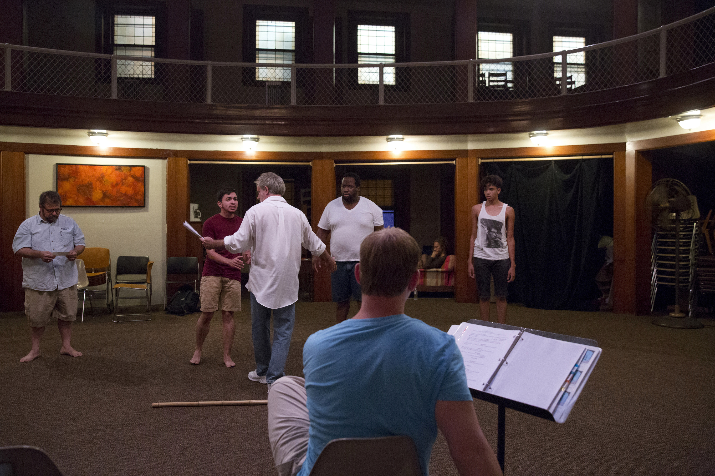 Younes rehearses a scene for The Tempest with his castmates at St. Mark's Evangelical Church in Baltimore.