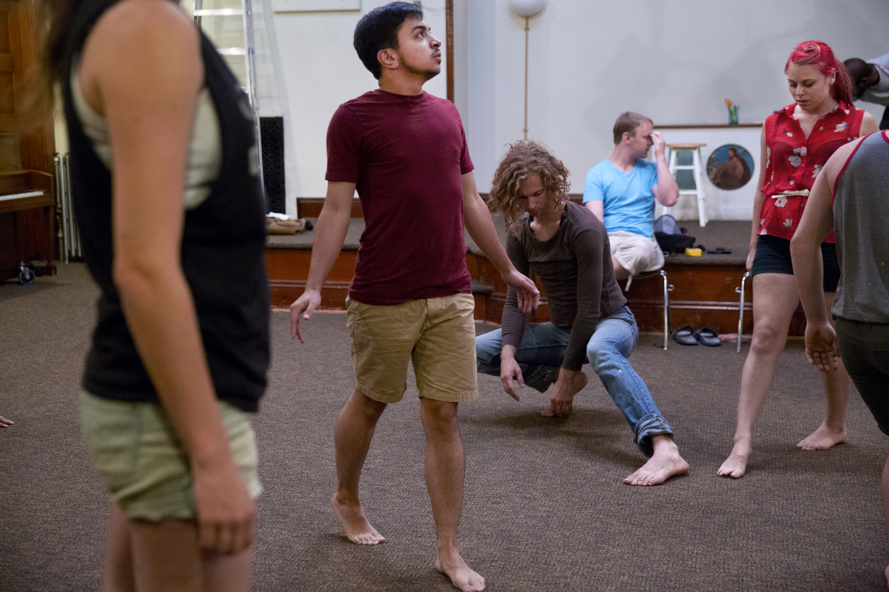 Younes participates in theater rehearsal. Most of the people he interacts with know of his transition, but there are several people who he knows may not.