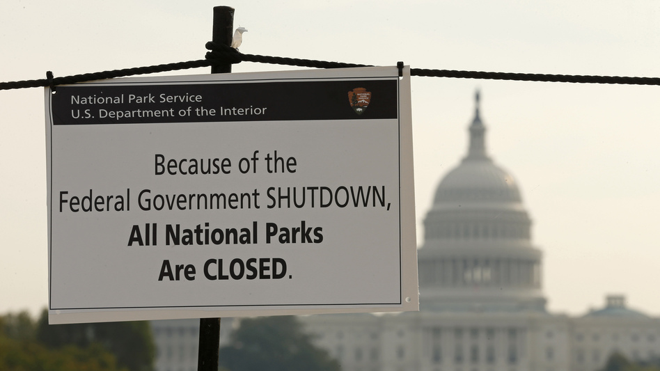 The U.S. Capitol looms in the background as a sign on the National Mall reminds visitors that national parks are closed because of the partial federal government shutdown. (Reuters/Landov)