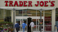 The specialty grocer Trader Joe's says next year it will end its policy of offering health benefits for part-time workers. Instead, the store will offer part-timers cash to help buy coverage.